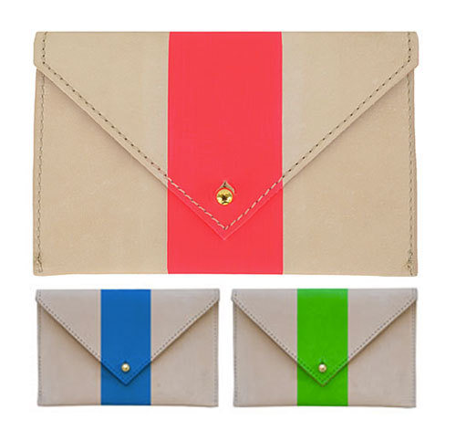La Pochette Claire Vivier has been a longtime favorite. Her gorgeous bags are all produced in Los Angeles. These clutches are made of natural undyed leather with a silkscreen bright stripe, and they're currently at the top of my most wanted list.