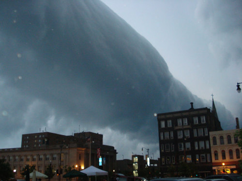 Roll Cloud Over Wisconsin  Image Credit: Pierre cb, Wikipedia Explanation: What kind of cloud is this? A type of arcus cloud called a roll cloud. These rare long clouds may form near advancing cold fronts. In particular, a downdraft from an advancing storm front can cause moist warm air to rise, cool below its dew point, and so form a cloud. When this happens uniformly along an extended front, a roll cloud may form. Roll clouds may actually have air circulating along the long horizontal axis of the cloud. A roll cloud is not thought to be able to morph into a tornado. Unlike a similar shelf cloud, a roll cloud is completely detached from their parent cumulonimbus cloud. Pictured above, a roll cloud extends far into the distance as a storm approached in 2007 in Racine, Wisconsin, USA.  via Astronomy Picture of the Day