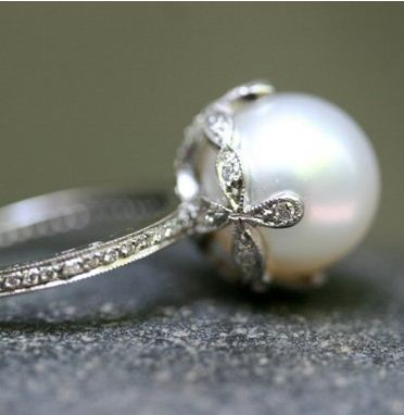 georgia-darlin:  I just love that. I love rings that have pearls instead of diamonds or any other kind of stone