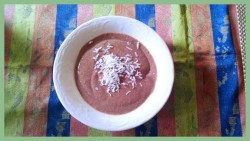 Quinoa Chocolate Pudding This is a variation of the earlier quinoa berry pudding. Satisfies the chocoholic in me. *1/4 c. quinoa cooked in 1 1/4 c. water *1/16 tsp. salt *sweetener to taste (I used 10 drops of SweetLeaf SteviaClear) *1 tsp. cocoa powder or more *1/4 box of Mori-Nu tofu *1/3 frozen overripe banana *Extracts (I used coconut extract; you can use vanilla)  *1 tbsp. nut butter of choice (optional) —————————————————————————- 1) Cook well rinsed quinoa in water, salt, and sweetener. Bring water to boil and cook covered for 20 min. on low heat. Add cocoa. 2) Let cool and blend away with all ingredients. 4) Enjoy warm or cooled and garnished with your favorite toppings, perhaps sliced strawberries or other fruit or nuts. If you let it sit or cool, it does thicken…if you can wait that long!