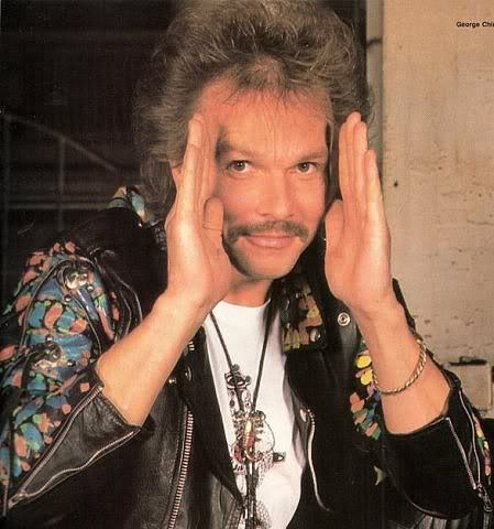 Happy 63rd (!) birthday to Scorpions guitarist and one-time mustache maven Rudolf Schenker. Even though the mustache is gone now and he looks oddly like Sting — a soul patch, really? — at least we'll always have this.