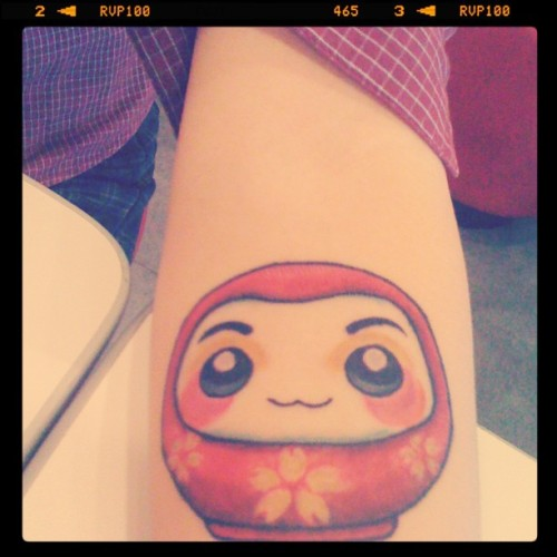 My first ever tattoo, daruma hime. Daruma dolls are seen as a symbol of perseverance and good luck, making them a popular gift of encouragement. The Daruma doll comes with both eyes blank. Upon purchasing or receiving it as a gift, you paint one eye and make a wish or begin a new project. The second eye is painted when the wish comes true or the project is completed. Done by Robin Gensel, Manila, Philippines. (08282011)