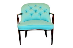 fit for a lady: this chair by edward wormley for dunbar is one of our favorite mid-century pieces. we love its elegant legs and feminine design. here, we've updated it with a punch of bold aqua.