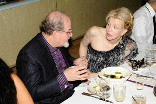 Speaking of Salman Rushdie, here he is with Courtney Love. We plebes sit next to people, Salman fucking Rushdie gets to sit next to characters. [via Refinery29]