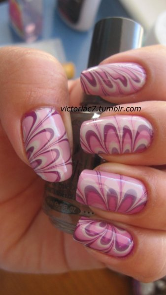 I of course had to do a water marble to test out some of my new polishes! I tried to do some petal like designs. Colors used: OPI - Pamplona Purple OPI - Sparrow Me The Drama OPI - Skull & Glossbones