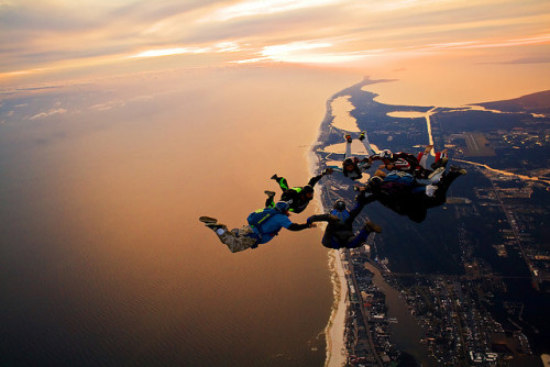 strangenormalities:  Skydiving Nov 2009, 7 way sunset load over the Florabama by divemasterking2000 on Flickr.