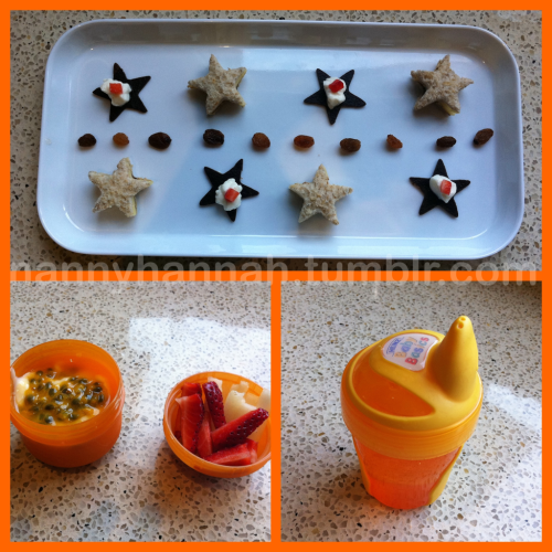 White plate:Cheese & vegemite sandwiches (cut into stars with a cookie cutter)Fruit strap stars (cut in the same way) topped with natural yogurt & a cube of strawberry Orange container & lid: Passionfruit yogurt topped with fresh passionfruit Pear & strawberry batons for dipping + a orange Sippy filled with water
