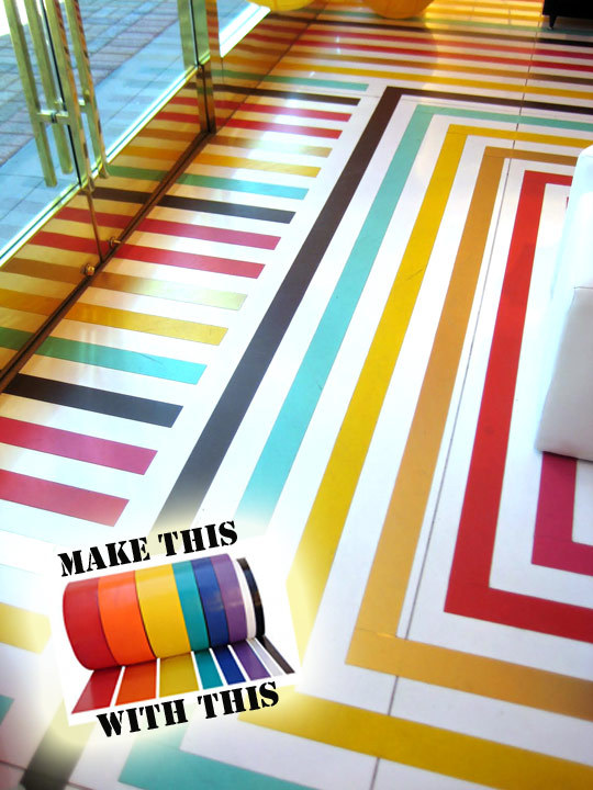 Vinyl Tape Floorboards | Apartment Therapy When I first saw this picture I was so taken with it. Where was this from? Someone's house? A store? After clicking through a million links my question was answered - it's from Kate Spade's store! That would probably be why I was so in love with it! This is so simple to achieve (though I would suggest getting someone to help you so you know it's going to be straight). It's achieved using the tape that they use to mark out the lines on a basketball court. It looks amazing. A super easy way to bring colour to your house without having to paint!