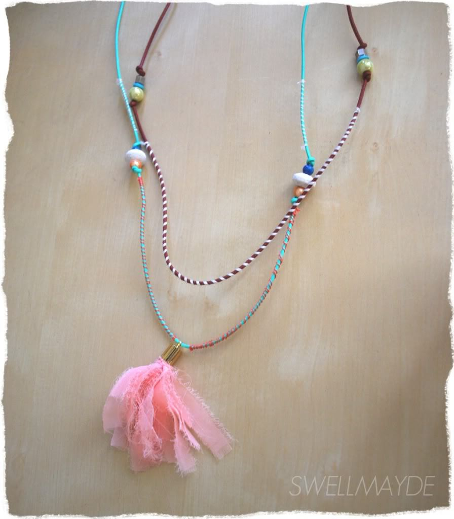 Tassle Necklace | Swellmayde This is like the most perfect Summer necklace! I can see wearing this with a white tshirt and a hippie-ish maxi skirt. This is made with a combo of beads, tassles and wrapping the cord with thread. This tassle is made with chiffon but you could also probably use a ready made tassle (though I like the floatines of this one!) I'm going to take this pic to the craft store with me so when I'm standing in the aisles trying to work out what I want to buy I can whip this out!