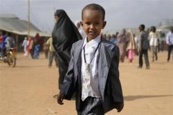 fyeahafrica:  A boy wears a new suit and tie as Somali refugees gather to pray during  celebrations of Eid al-Fitr to mark the end of Ramadan in the Ifo  marketplace at Kenya's Dadaab Refugee Camp, situated northeast of the  capital Nairobi near the Somali border, August 30, 2011.    Photo by REUTERS/Jonathan Ernst   via kilele  This is positively adorable. Consider this your D'awwwwww of the day.