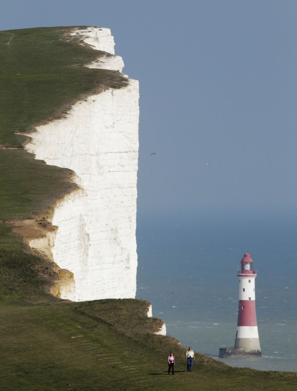 Photos of the dayA couple walk along the Seven Sisters cliffs close to the Beachy Head lighthouse near Eastbourne, England, Sept. 1, 2011. (Luke MacGregor/Reuters)