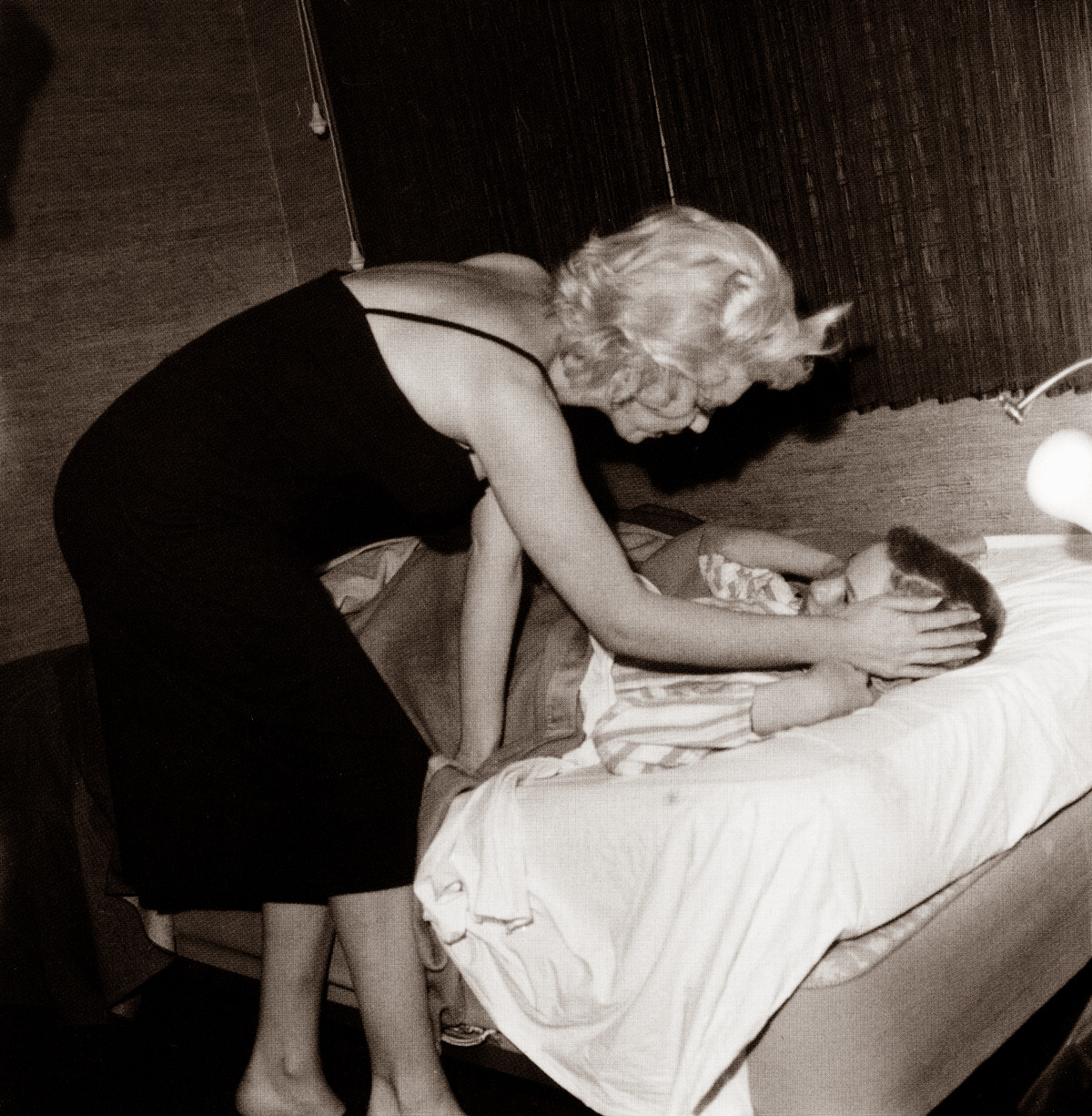 tinasinatra:  Marilyn Monroe puts a little boy to bed. Photographed by Sammy Davis, Jr.