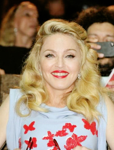 hot #Madge madonnaciccone:  First photo of Madonna from inside the movie theater. Look at our girl looking so proud and excited! ♥