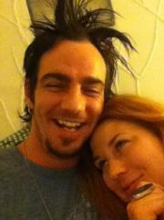 iloveadamgontier:  adam gontier with his wife naomi…LOVE THE HAIR LOL!!!   Oh my god.. x'D He's so silly~