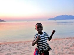 Girlfriend & me had a great time in Malawi Africa. This is a little boy dancing near Lake Malawi, Cape Maclear.