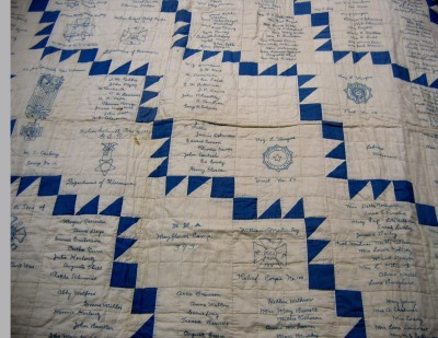 jbe200quilts:  Description: Pieced, blue and  white cotton signature quilt, filled with hundreds of embroidered names  and the insignia of many auxiliary military organizations. Other Notes: This quilt was  found in the collection of the La Crosse County Historical Society. The  donation had never been properly accessioned, and no deed of gift has  been located.
