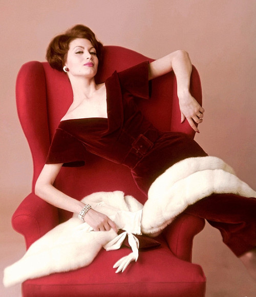 theniftyfifties:  Model in a red velvet dress for Vogue, 1959.  When's Mad Men coming back again?!