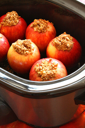 Crock Pot Baked Apples. Perfect fall tailgating treat!  Ingredients 1/4 cup brown sugar1/4 cup walnuts, chopped2 tablespoons trans-fat free margarine1 teaspoon cinnamon6 Gala or Macintosh apples, cored1/2 cup apple juice or apple cider2 tablespoons orange liquor (optional) Directions Preheat a large crock-pot on high heat and preset it for 3 hours. In a large bowl, mix brown sugar, walnuts, margarine, and cinnamon. Fill the apples with the filling and place them in the crock-pot. Pour in the apple juice or cider and the liquor, if using. Cover and cook 2 1/2 to 3 hours on high heat until the apples are soft and begin to collapse.