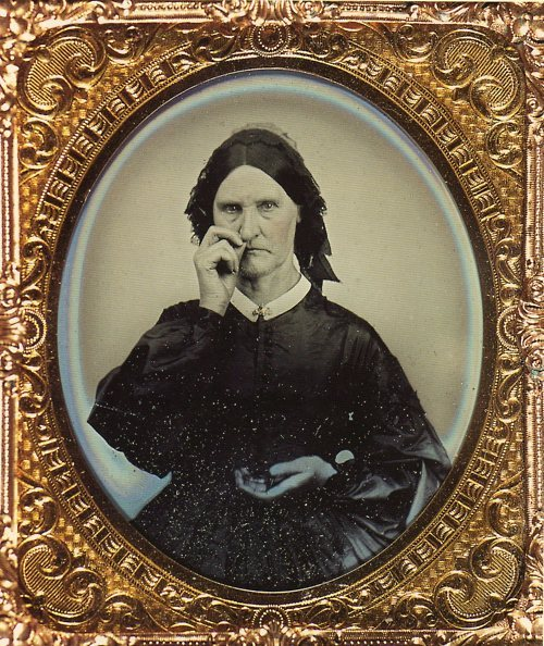 1855 Lady using snuff.   (via ratsoff and holdthisphoto)