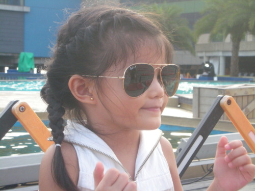 My 'lil sis, Kalei who's wearing my mom's aviator glasses. :D Such a cutie.