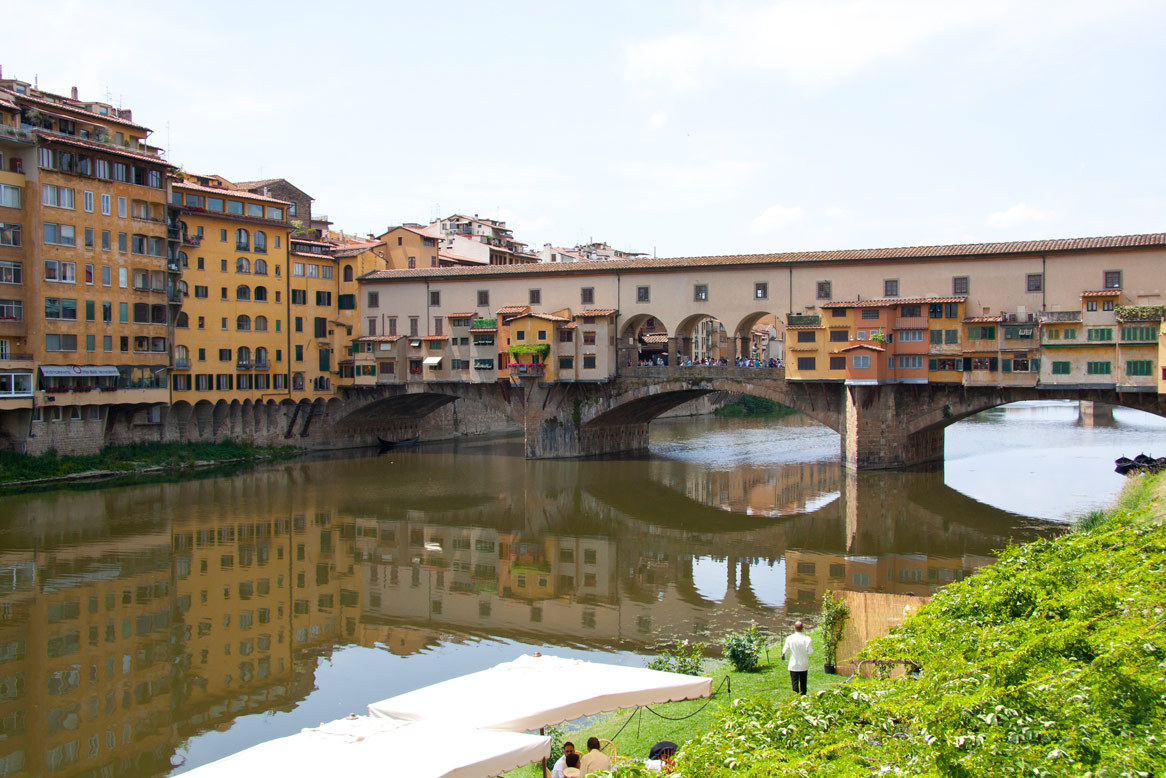 FLORENCE, ITALY 2011 this image is of the Ponte Vecchio bridge. it is a beautiful medieval stone covered bridge that crosses the Arno River. there are several jewelry, art, and souvenir shops inside the bridge. it was first built in 996 but was rebuilt several times. it was the only bridge in Florence that was not destroyed by the nazis.