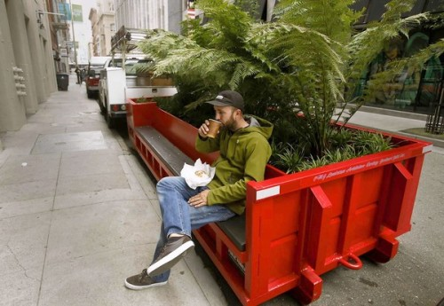 "Tiny parks are on a roll in San Francisco: Two dumpsters full of greenery, with four more to come, add a bit of nature to the streets of a paved-over downtown neighborhood. Some scoff, but others are willing to give the ""parkmobiles"" a go. Photo: Dave Vetrano takes a coffee break at a parkmobile in San Francisco's South of Market district. Credit: Mark Boster / Los Angeles Times"
