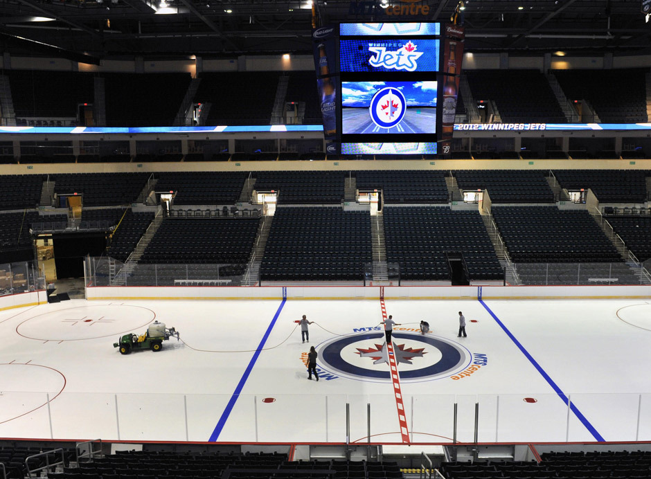 nationalpostsports:  Ice technicians install the Winnipeg Jets logo at centre ice of the MTS Centre. Fred Greenslade/Reuters