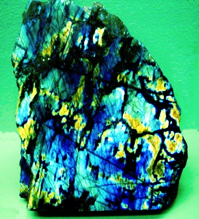 Labradorite [(Ca,Na)(Al,Si)4O8] Labradorite is one of the plagioclase feldspars that lies Anorthite CaAl2Si2O8 and NaAlSi3O8. Compositionally, Labradorite is An50-An70 A. The distinctive play of colors is called labradorescence and is caused by the schiller effect: the result of light refracting within lamellar intergrowths resulting from phase exsolution on cooling in the Boggild miscibility gap, An48-An58.