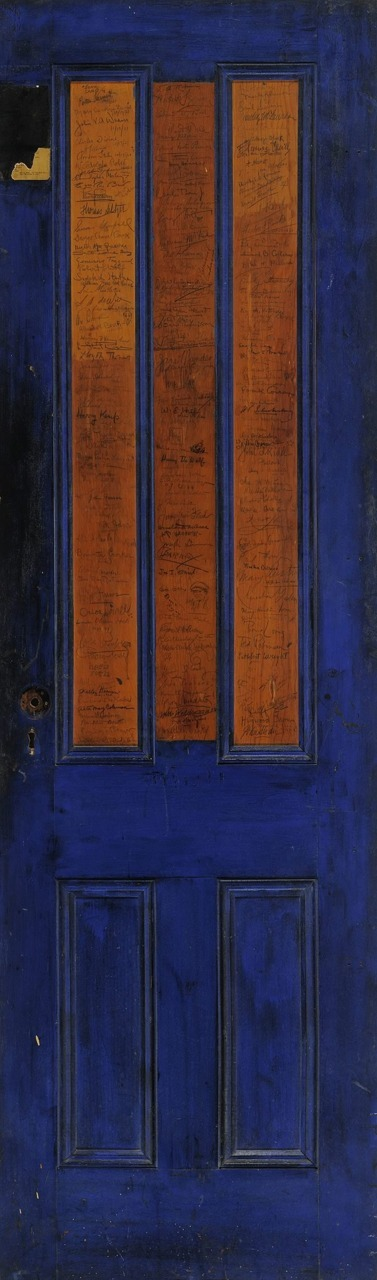 A signed bookstore door, from Greenwich Village in the '20s. (Story here.)