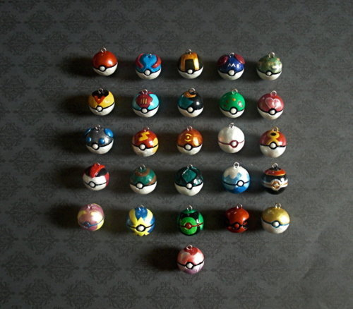 wickedclothes:  Pokeballs galore! All Pokeballs are hand-crafted one-by-one and painted with accuracy and dedication. The dividing black line is carved out, including any extra detail depending on the pokeball type. Found on DeviantArt.