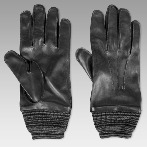 Paul Smith Mono-cuff leather gloves.As worn by Sherlock in series 1. Visible top stitching. Wool lining.£175 / $284 Available here at PaulSmith.co.uk These are the current season's update of Sherlock's gloves. The ones he wore in the show have been discontinued and featured small holes just past the knuckles and didn't feature a cuff.