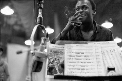 "ckck:  Miles Davis while recording ""Porgy and Bess"" with Bill Evans at the 30th Street Studios, New York City. July, 1958. Photograph by Don Hunstein."