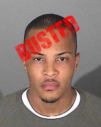 Rapper T.I. is back behind bars on Friday just two days after walking out of an Arkansas prison a month early.  The 30-year-old Atlanta-based rapper, whose real name is Clifford Harris, was placed back in custody to federal agents on Thursday.  Apparently, law enforcement officials are questioning T.I.'s use of a luxurious tour bus after he left prison on Wednesday.