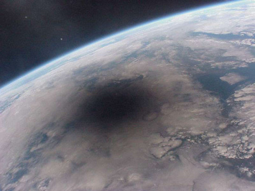 ianbrooks:  Solar Eclipse as seen from Space From August 11th, 1999, as photographed from the now asploded MIR Space Station. (via: apod.nasa.gov)