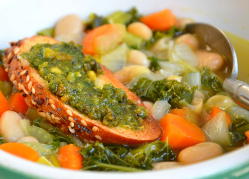 Kale & White Bean Soup with Pistachio Pesto Toast Soup tastes so great when you make it from scratch and is very easy. This is great as a pasta dish too, just cook some pasta separately and serve it with the soup. It's inexpensive to make, really healthy, vegetarian, high protein and gluten free. (If you leave off the pasta & pistachio toast, but, that was my favorite part.) Chop 1 leek, 2 carrots, 3 stalks celery and 1 med onion and saute them in a heavy bottomed stock pot with 2 tblsp butter or olive oil. Add 1 can rinsed and drained white beans, 1 container of chicken or veggie stock, 2 cups chopped kale, 2 tblsp fresh chopped parsley, 2 smashed garlic cloves, salt and pepper, 1 tsp smoked paprika, and 1/2 tsp thyme or basil or both. Simmer until the kale is cooked and all the flavors come together, about 20 -25 minutes. Serve with pistachio pesto toast. For the pesto: In a dry skillet, roast 3/4 cup pistachio nuts on low heat. This only takes a few minutes. Once cool, combine in a food processor with 1/2 cup parmesan cheese, 1 large smashed garlic clove, salt and pepper and about 1-2 cups fresh basil leaves. Drizzle in 1 tblsp olive oil or as much as 1/4 to 1/2 cup of olive oil. Spread on toasted french bread and serve with your soup. Yummy!
