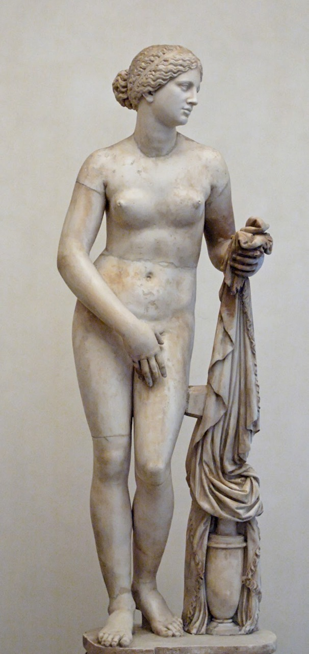 Late Classical period (ca. 400-323 BCE) Aphrodite of Knidos (ca. 350-340 BCE) by Praxiteles (Roman copy). The first nude statue of a goddess.  More focus on the real world of appearances than to the ideal world of perfect beings. Smaller heads and slimmer bodies. The expression is more passionate and sculptors had a more individual style than earlier.
