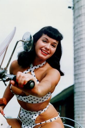 Bettie Page- a wonderful example of a real woman who didn't need to weigh 100 pounds to be considered beautiful.