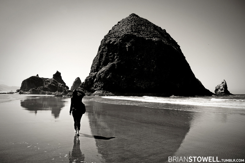 Jenni walking towards Haystack Rock at Cannon Beach, OR.