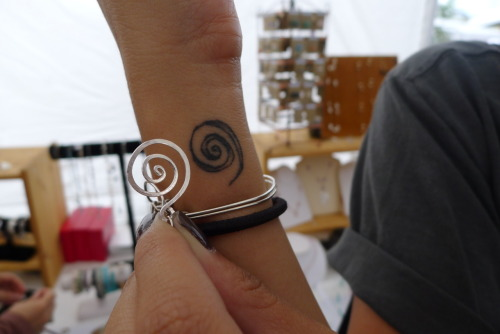 Found a jewelry maker who incorporates spirals into most of her work (sound like someone you know?). This one was straight TRIPPY. Jewelry made from a vendor you've never met that somehow EXACTLY matches the tattoo you got that's actually based off a drawing you did almost 3 months ago (see here)? That's some parallel universe other world next level shit.