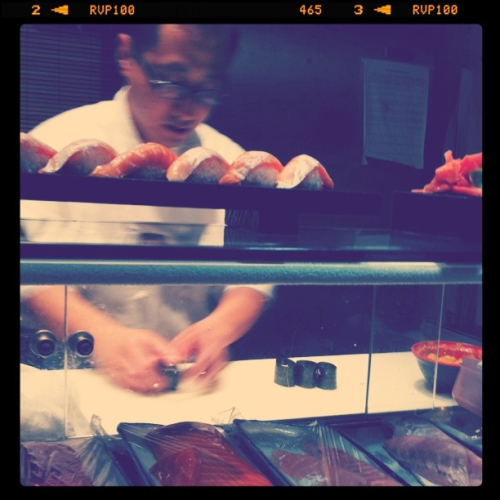 Sushi man making my spicy scallop sushi @ Osaka - a great hole in the wall Sushi place in Austin. On the counter = sake toro, fatty salmon.
