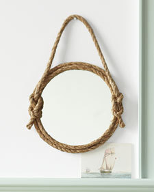 One more mirror idea! This time, the use of rope adds a lot of interest to an otherwise uninteresting piece. (via Rope Mirror How-To - Martha Stewart Good Things)