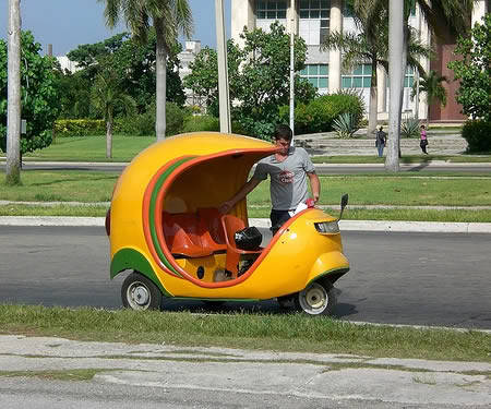 scooter pic of the day: a coco taxi, apparently a common vehicle in cuba. cuba has the coolest vehicles.