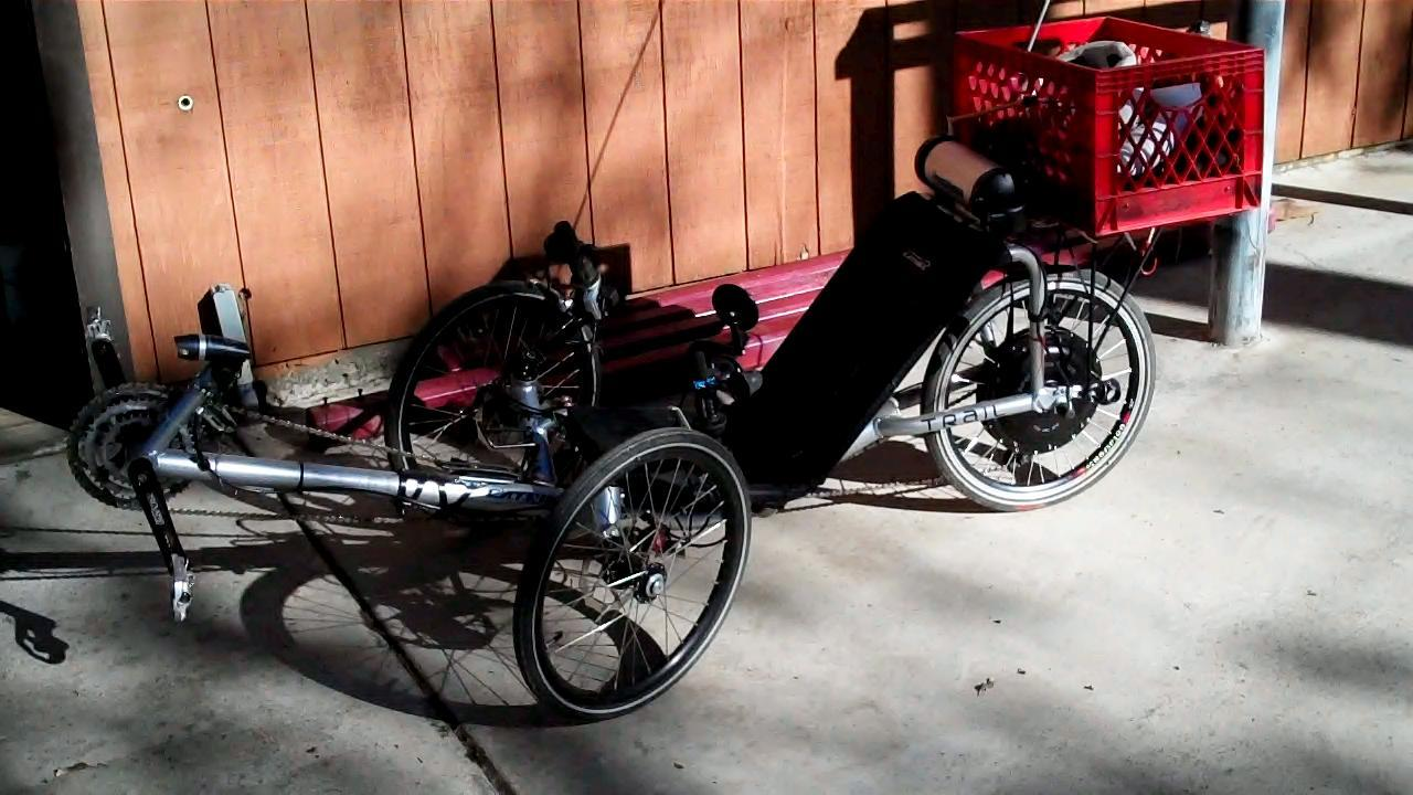 Recumbent trike with a milk crate cargo box. Electric Assist rear wheel.