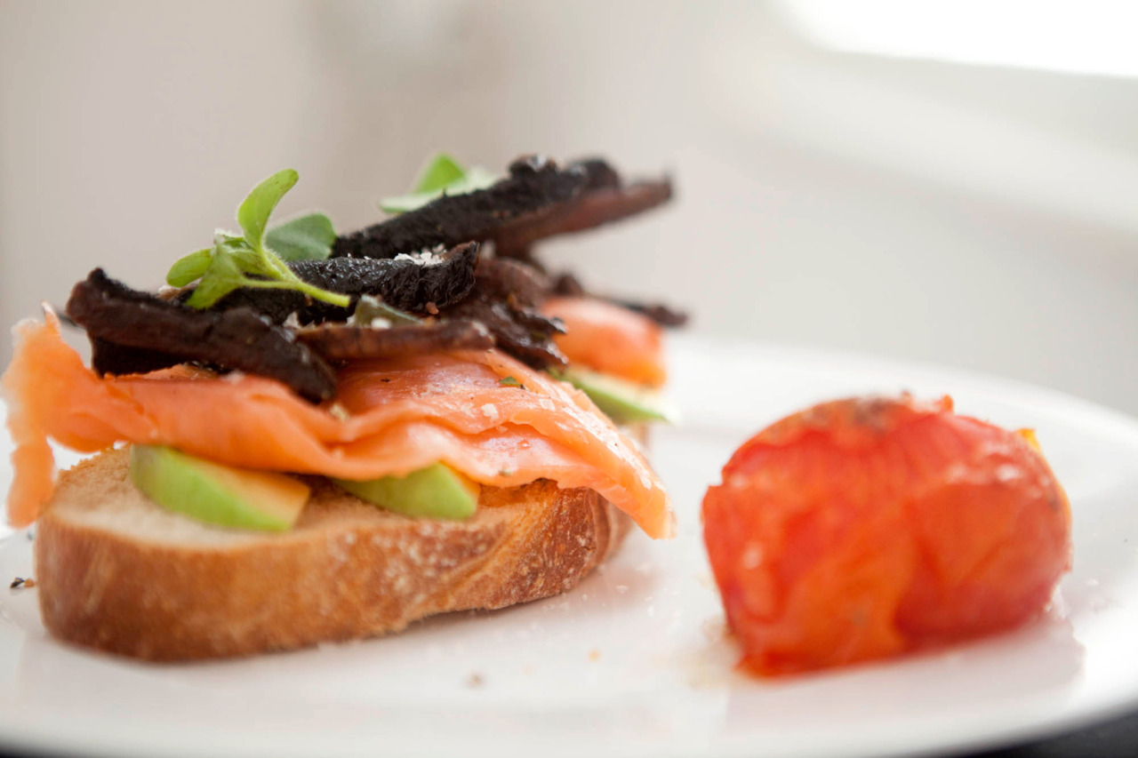 Herb Roasted Mushrooms and Tomato with Smoked Salmon and Avocado Ingredients (serves 2): 2 portabello mushrooms, sliced 2 tomatoes 3 tbsp fresh oregano 2 tbsp olive oil Salt and pepper 2 thick slices of bread (toasted) 1/2 avocado, sliced Small packet of smoked salmon Heat the oven to 200C / 375F.  Toss the tomatoes and mushroom in herbs, oil, salt and pepper, and bake for about 30 minutes, stirring the mushrooms halfway though.  Layer the avocado and salmon between the 2 slices of toast, top with the mushrooms and serve with the tomato. Oh, and just a friendly reminder to vote for me in the Blogster Awards, not that you haven't already :)
