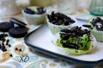 breakfast-brunch-dessert:  Grasshopper Mint Oreo Cookie Cups 8 ounce(s) of cream cheese  1/3 cup(s) of sweetened condensed milk  1 egg  1/4 tsp. of peppermint extract  1/4 tsp. of vanilla extract  1 tbsp. of flour  15 OREO cookies  1/3 cup(s) of mini chocolate chips Directions In a large bowl, combine cream cheese, sweetened condensed milk, egg, peppermint extract, and flour. Mix together with an electric beater until light and fluffy.  Stir 1/4 c. of the mini chocolate chips into the PHILADELPHIA CREAM CHEESE mixture.  Line muffin tin with cupcake wrappers.  In the bottom of each cupcake wrapper, place one full OREO cookie.  Spoon cream cheese mixture over the OREO cookies, filling the muffin tins to 3/4 full. (There will be enough batter to fill 9 rounds.)  Coarsely crush the six remaining OREO cookies, then sprinkle over the cream cheese layer in each muffin cup.  Sprinkle remaining mini chocolate chips over the cream cheese layer in each muffin cup.  Bake in an oven preheated to 325 degrees for 20-22 minutes, or just until the cream cheese layer puffs and sets up slightly.  Remove from oven and allow to cool before serving.  If desired, serve with a dollop of fresh whipped cream for garnish. Enjoy!