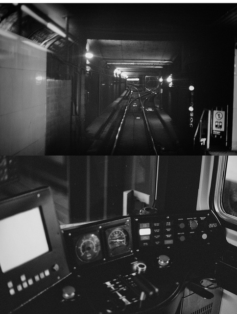 Subway DIPTYCH on Flickr.Nikon FE2Nikon NIKKOR 50mm f/1.4 AISKodak BW400CN Professional ISO 400So apparently when you catch the last subway on a weeknight, the operator is eager to go home and may leave his control booth door unlocked and free to swing wind open. Perhaps if I hadn't been going home from the bar, the photos would have been more focused