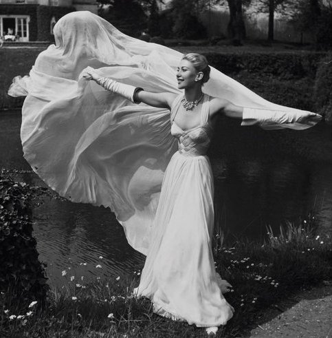 theniftyfifties:  Model wearing a gown by Jean Desses, 1953.