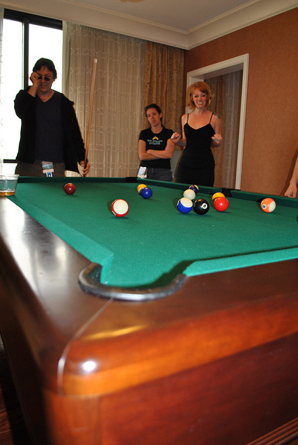 DSC_0019 by SamHeartsArt on Flickr.Here I am losing at pool to Richard Hatch from Battle Star Galactica at the DragonCon 2011 Media Party. photo by Sam Mitchell