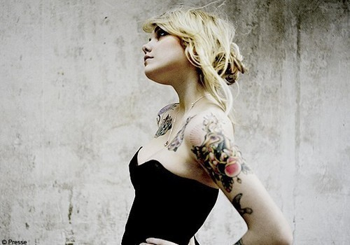 Cœur de pirate. Not only is she gorgeous, but she is a great Québécoise singer. :)