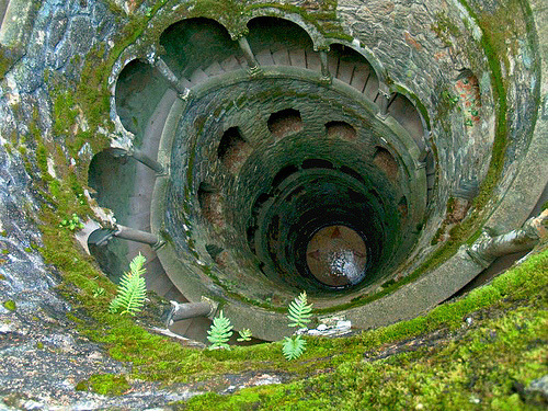 petitpoulailler:  dazzlingagony: The Initiation Well photography by isolano  In the town of Sintra, the Quinta da Regaleira, an extremely beautiful architectural complex, includes an early twentieth century palace and a garden. Specialists consider that the estate reveals and symbolises Masonic rituals, although no-one knows whether the original owner of the estate, António Carvalho Monteiro, actually practised Masonic rituals on the site, or simply desired to perpetuate the imaginary universe of this secret cult. The garden includes labyrinthine galleries and subterranean grottoes, which can be accessed from this dry well, 60 metres deep, 9 stairwells each with 15 steps.